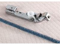 Лапка для оверлоков Brother для настрачивания тесьмы (арт. Х76663-001)
